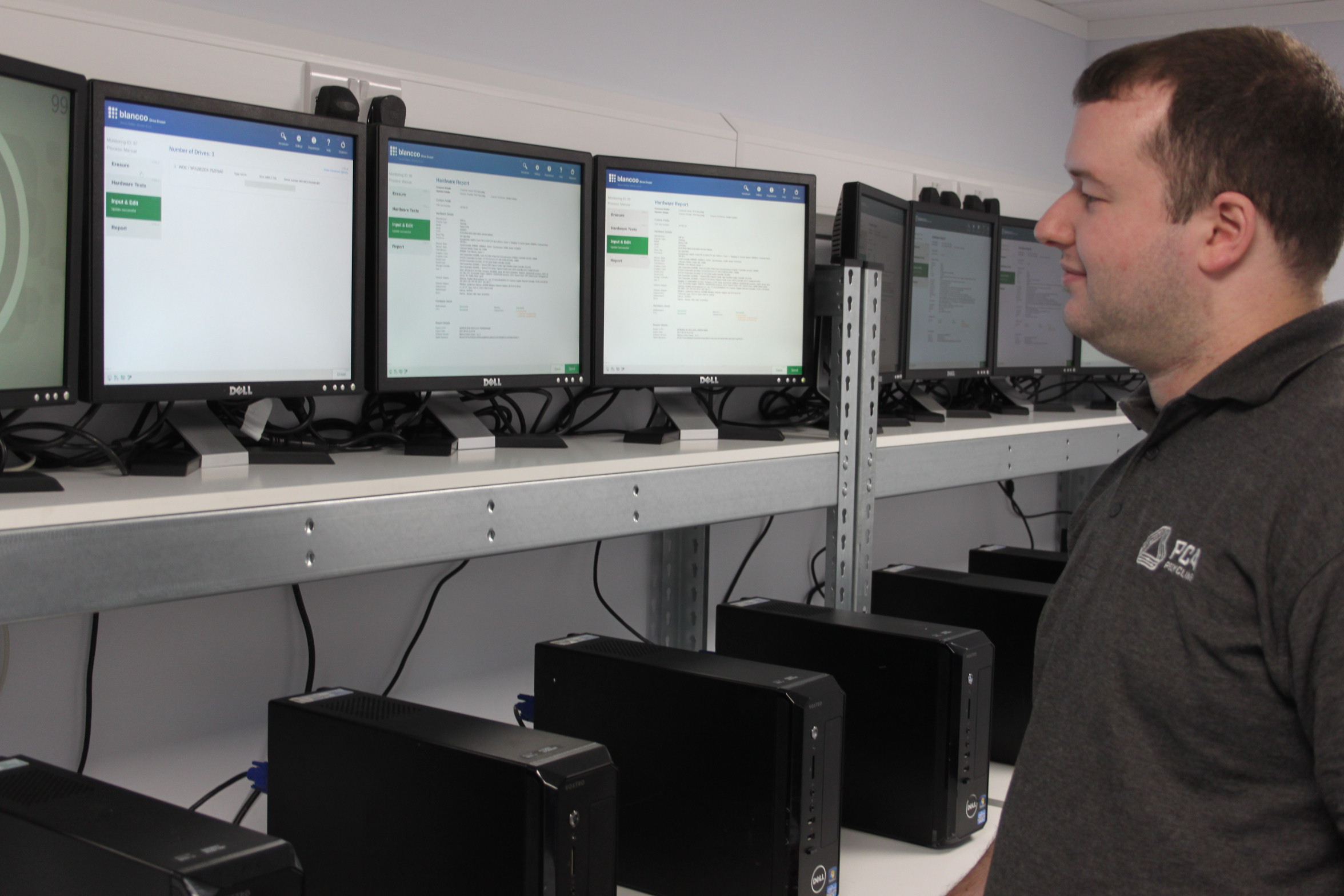 PC4 Recycling technician wiping multiple PCs with Blancco