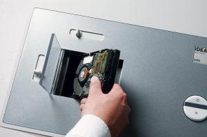 Placing hard drive within hard drive destruction machine